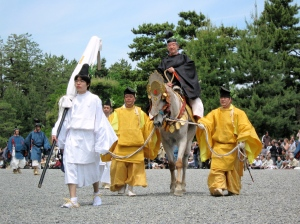 Priests and shrine wardens lead horses and palanquins through northern Kyoto